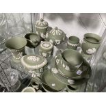 A large quantity of Wedgwood Jasperware, of green ground, all decorated with classical scenes,
