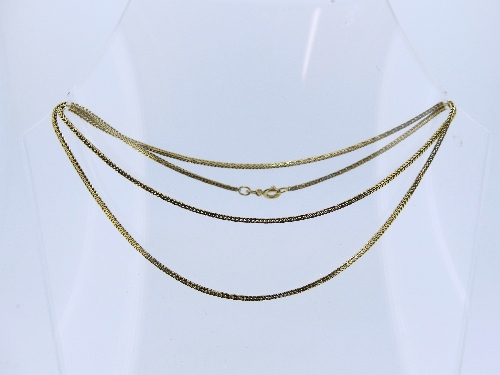 An 18ct yellow gold snake link Chain, 23in (59cm) long, approx total weight 7.9g.