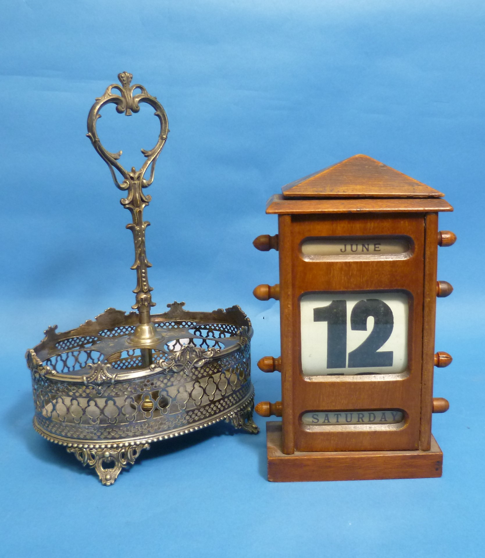 A Victorian mahogany desk/hanging Calendar, with apertures for month, date and day, 9½in (24cm)