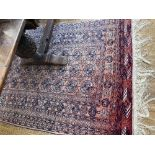 Tribal Rugs; a Bokhara rug the pink ground woven all-over with tekke set within a geometric
