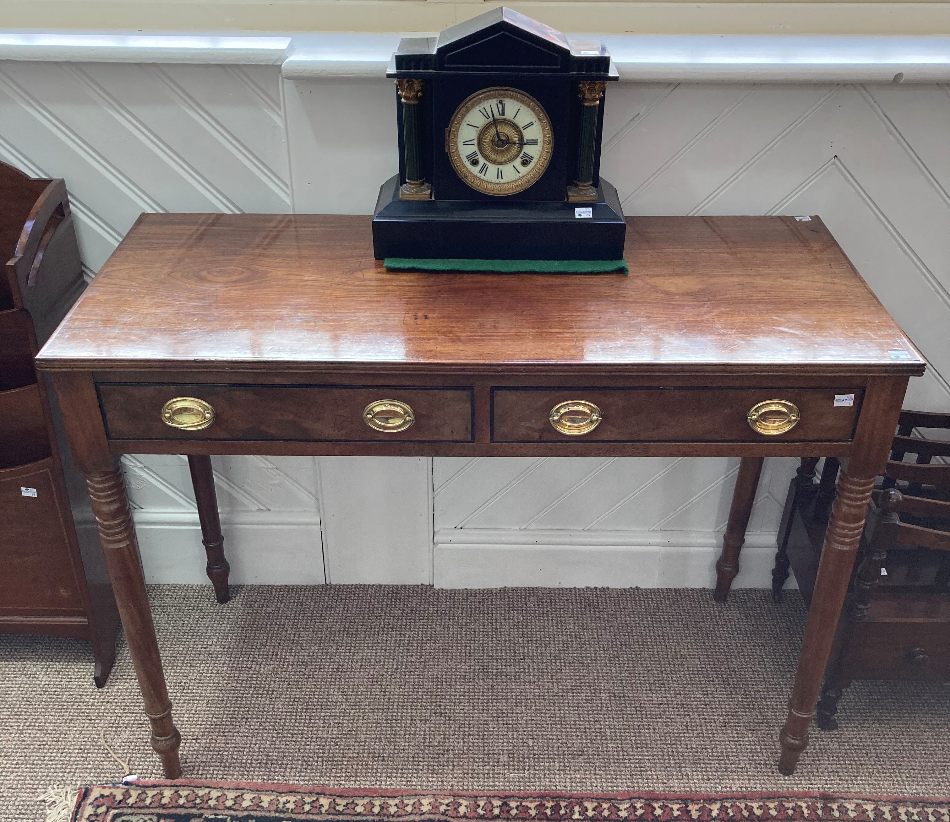 A 19th century mahogany Side Table, the rectangular top with reeded edge above to frieze drawers, on