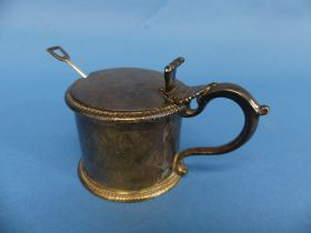 A Victorian silver Mustard Pot, by Susanna Cook, hallmarked London, 1852, of circular form with