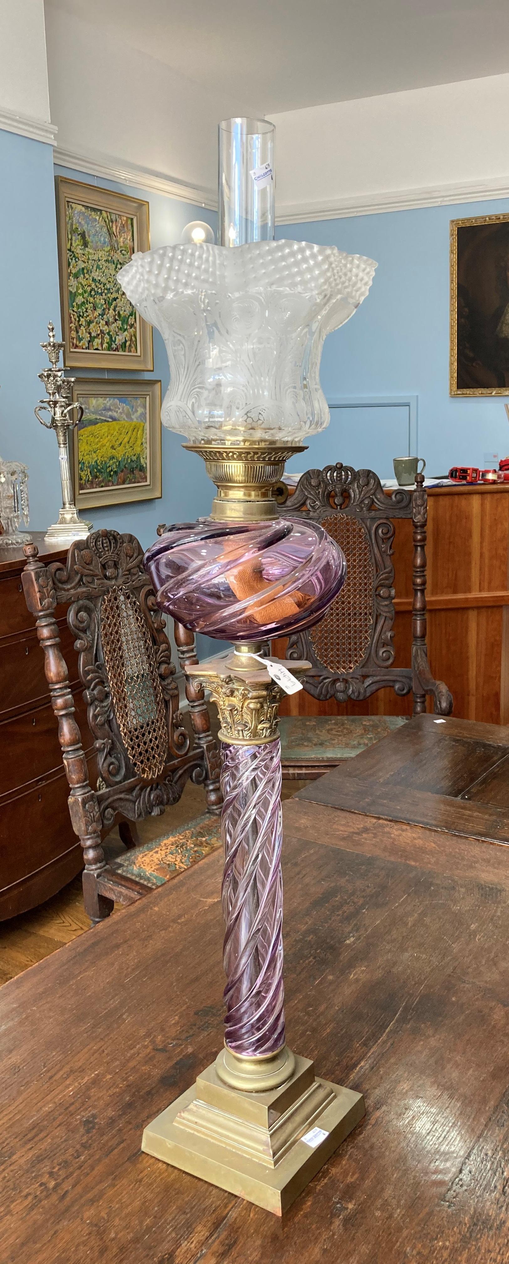 A Victorian purple glass and gilt brass Corinthian column Oil Lamp, the purple glass spiral twist