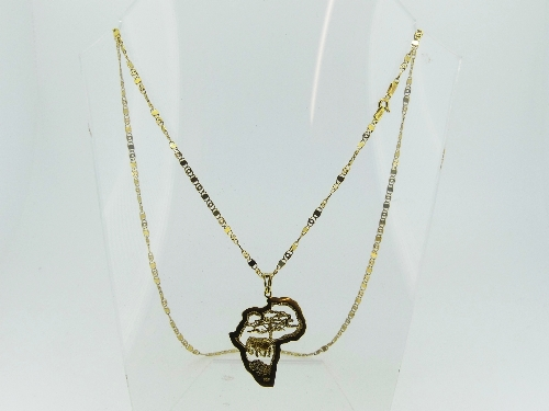 An 18ct yellow gold Pendant, pierced in the outline of the African Continent, with an elephant and