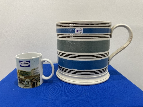 A large late 19thC Staffordshire pottery Mug, with banded decoration, 8in (20cm) high, firing cracks
