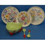 A pair of Poole pottery floral Chargers, 12¼in (31cm) diameter, and another similar, smaller,