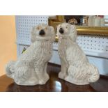 A pair of Staffordshire pottery Spaniel dogs, approximately 12in (30.5cm) high, together with an