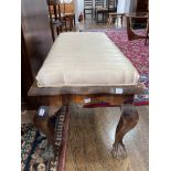 A late 19thC/early 20thC mahogany framed Stool, the cream upholstered stuffed seat, on somewhat