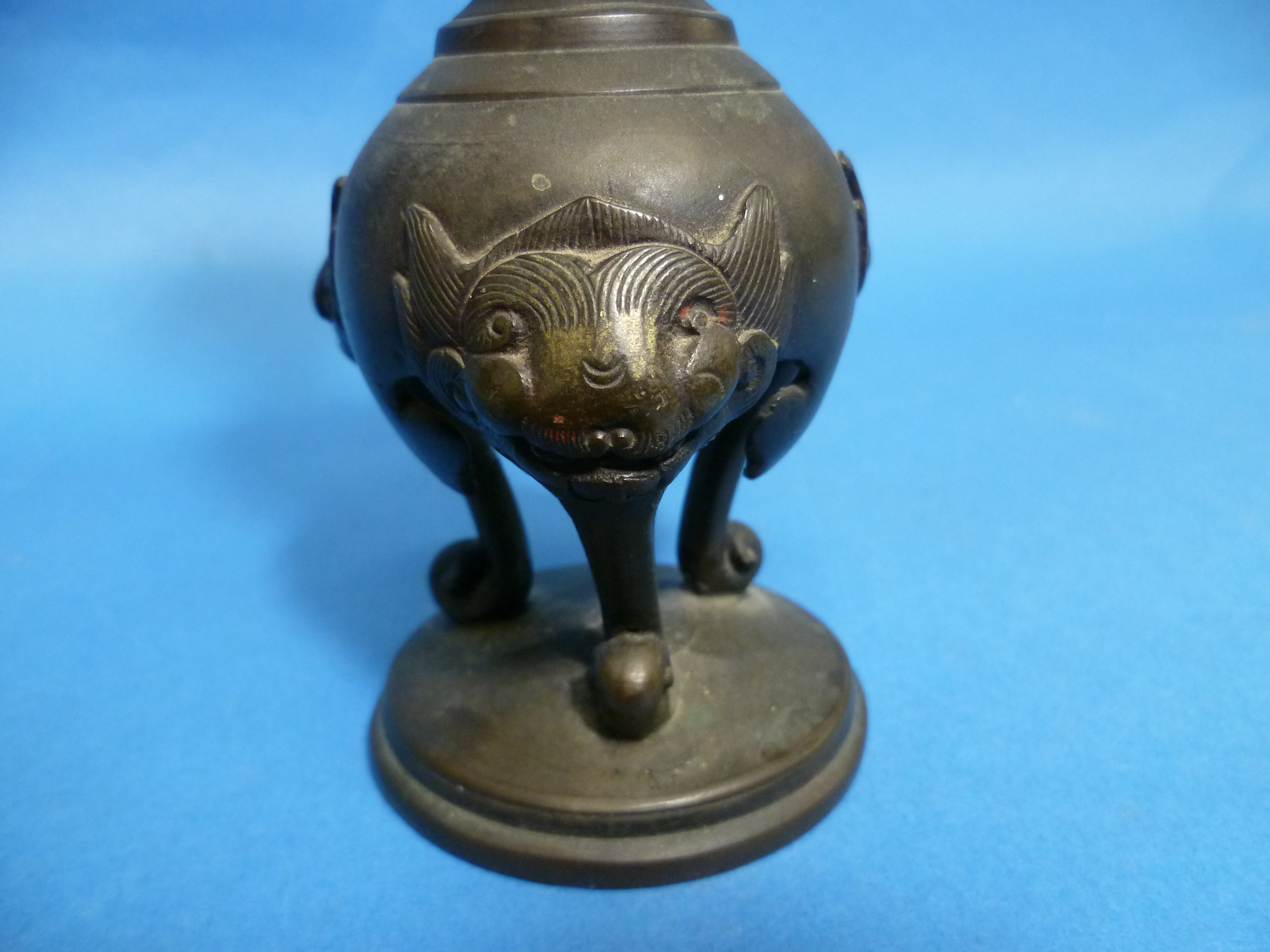 An antique Oriental bronze Candlestick, embossed in relief with three-toed dragons, dogs of Foo, - Image 3 of 4