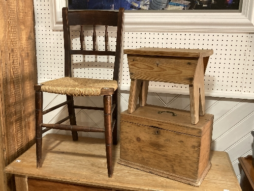 An early 20thC rustic pine shoe-shine Stool, together with a rustic pine box and a rush-seated chair