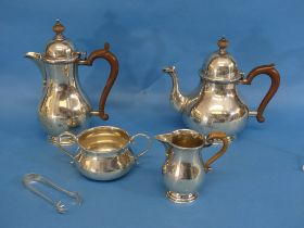 A George V silver harlequin four piece Tea Set, the teapot, sugar bowl and cream jug all by
