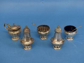A George V silver five piece Cruet Set, by S Blanckensee & Son Ltd., hallmarked Birmingham, 1935, of