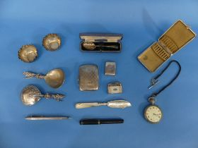 A mixed quantity of silver Items, including a small travelling silver cased watch, hallmarked