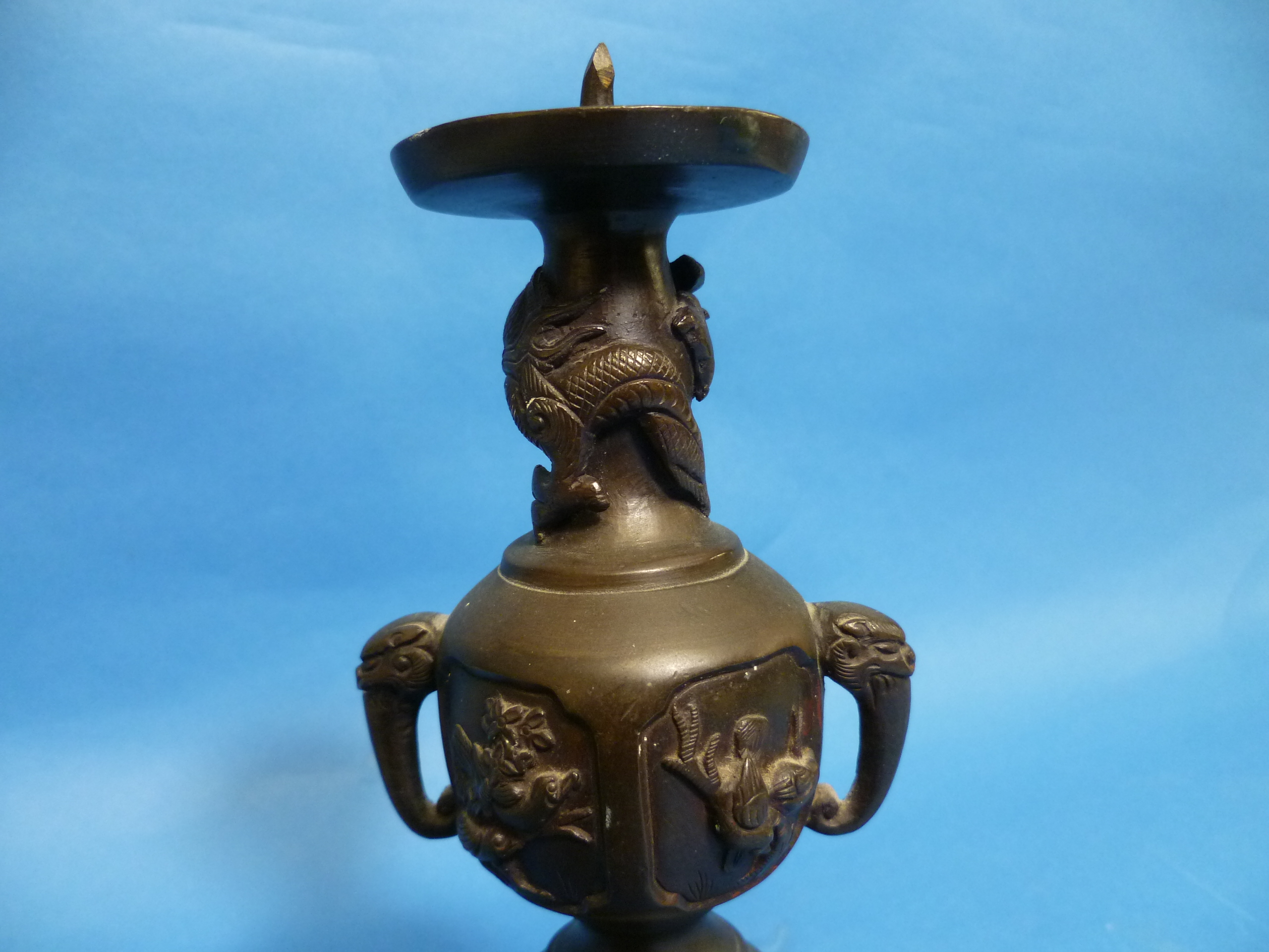 An antique Oriental bronze Candlestick, embossed in relief with three-toed dragons, dogs of Foo, - Image 4 of 4
