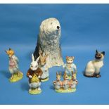 A Beswick pottery Old English Sheep Dog, MN.453, 8½in (21.5cm) hall, and a Beswick pottery Siamese