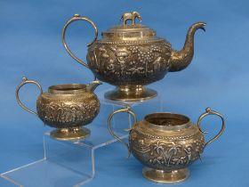 An Anglo-Indian silver three piece Tea Set, unmarked but tested, of circular form, the teapot with