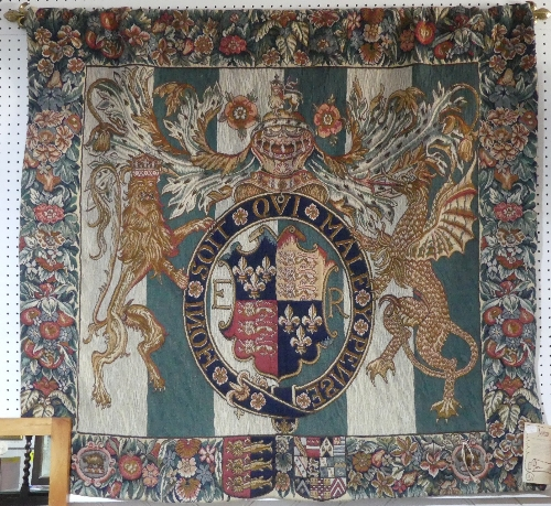 A machine made Belgian 'Metrax' hanging tapestry of The English Coat of Arms, 51in x 56in (130cm x