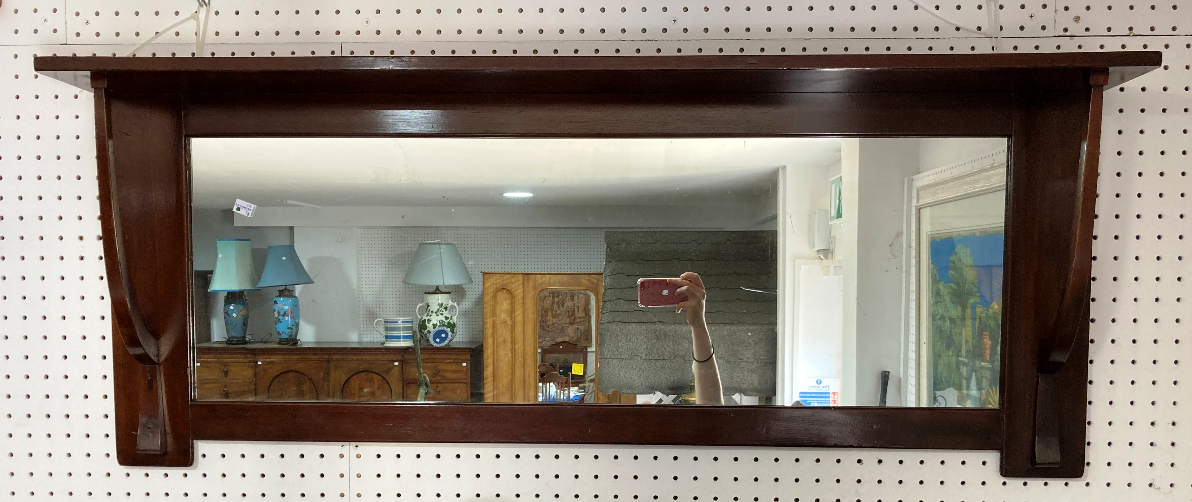 An Edwardian Arts & Crafts 'Liberty' walnut overmantle Mirror, of rectangular form with plate-