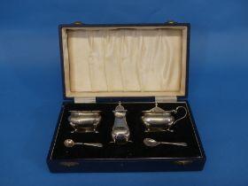 An Elizabeth II silver three piece Cruet Set, hallmarked Birmingham, 1959, the mustard pot and