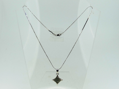 A contemporary 18ct white gold diamond shaped Pendant, the centre with sixteen small pale green
