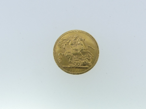 A George V gold Sovereign, dated 1912.