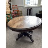 A Victorian oak Breakfast Table, the oval top with incised decoration to the edge, raised on bulbous