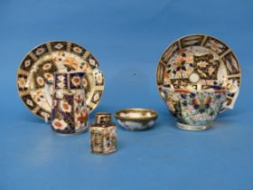 A 19thC Royal Crown Derby 2451 pattern Tea Cup and Saucer,decorated in the typical imari