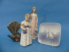 A Royal Copenhagen figure of a Child holding a Baby,with factory mark to base, together with a