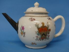 An 18thC Chinese Export Armorial Teapot, decorated in floral sprays with central crest and gilded