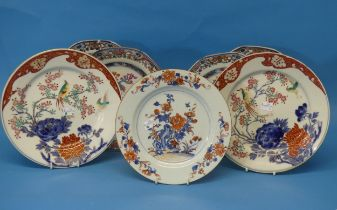 A set of four 18thC Chinese export Famille Rose Plates,of octagonal form, in the Famille Rose /
