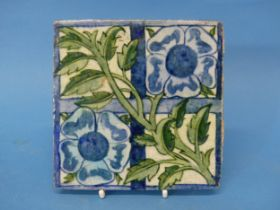 A William de Morgan 'Rose Trellis' pattern Tile, the tile decorated with rose and trellis, in greens