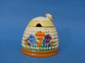 An early 20thC Clarice Cliff Newport Pottery 'Spring Crocus' pattern Honey Pot,with bee finial,