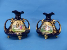 A pair of early 20thC Continental porcelain Vases,the twin handled Vases, in blue ground, with