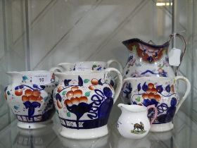 Set of four graduated Staffordshire Jugs,decorated in the imari palette, together with Large