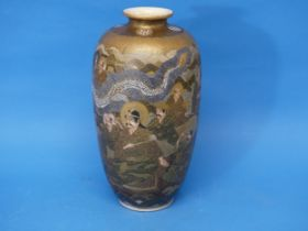 An early 20thC Japanese Satsuma Vase, depicting characters' faces, dragons and temples, with a