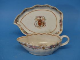 An 18thC Chinese Export Armorial Porcelain Sauce Boat and Saucer,bearing the crest of the