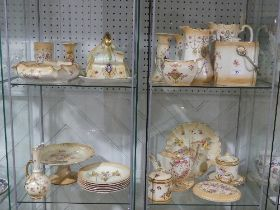 A large quantity of Crown Devon in Blush Ivory style, comprising three Jugs (graduated in size),