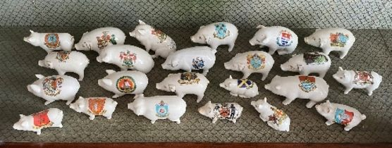 A large quantity of Crested China Pigs, all painted with different crests and place names, with