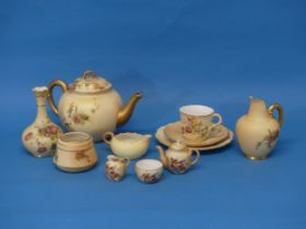 A small quantity of Royal Worcester Blush Ivory;comprising a Tea Cup, Saucer and Plate, together