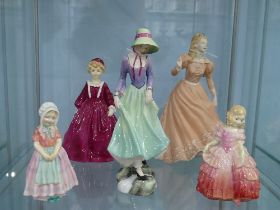 A Royal Doulton 'Grandmother's Dress' Figurine,together with 'Tootless', 'Rose' and 'Polly' all