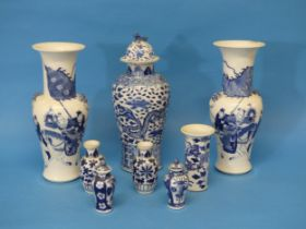 A pair of early 20thC Chinese Blue and White Vases, the body decorated with warriors, with a six