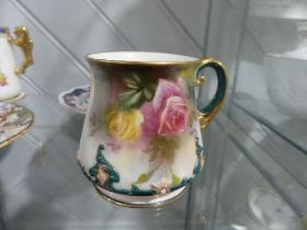 A Hadleys Worcester Mug, the floral painted body with foliate decoration in relief, together with