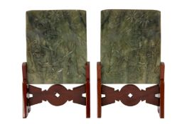 A PAIR OF CHINESE GREEN JADE 'LADY AND BOY ' TABLE SCREENS.