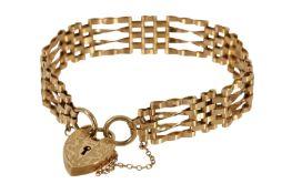 A GOLD GATE-LINK BRACELET,