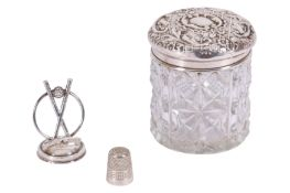 AN EDWARDIAN DRESSING TABLE JAR WITH A STERLING SILVER LID