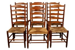 A SET OF FIVE COTSWOLD SCHOOL YEW WOOD LADDER BACK DINING CHAIRS BY EDWARD GARDINER