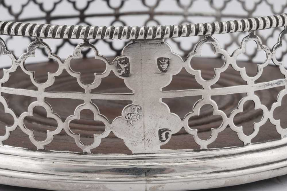 An unusual pair of George III sterling silver wine coasters, London 1768 by Thomas and William Chawn - Image 4 of 4