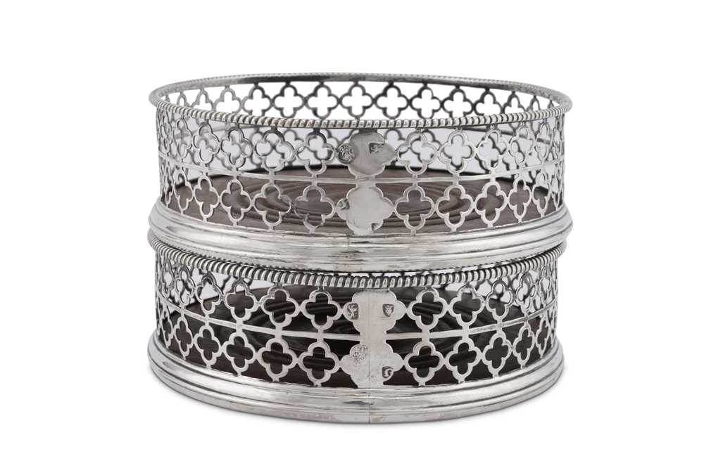 An unusual pair of George III sterling silver wine coasters, London 1768 by Thomas and William Chawn - Image 3 of 4