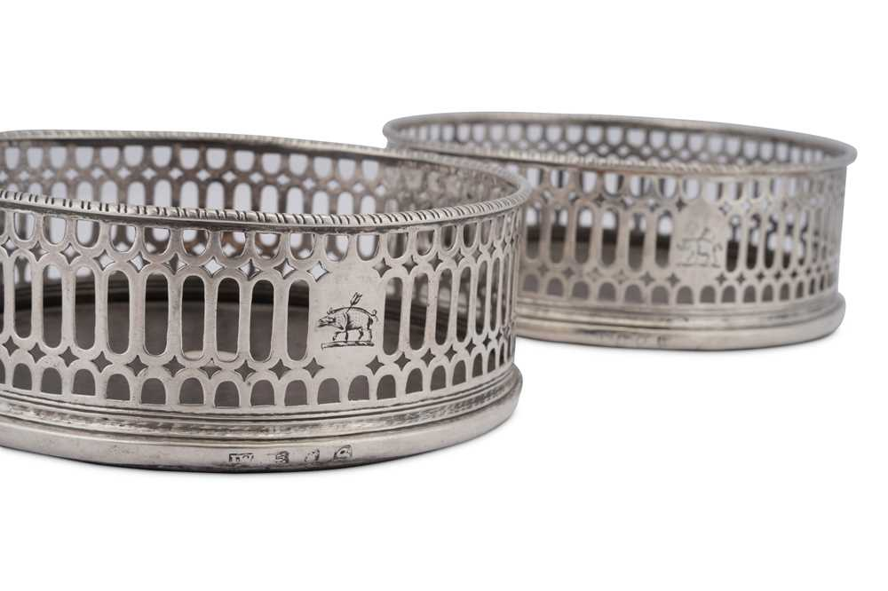 A pair of George III sterling silver wine coasters, London 1773 by I.W possibly for John Weldring (G - Image 2 of 3