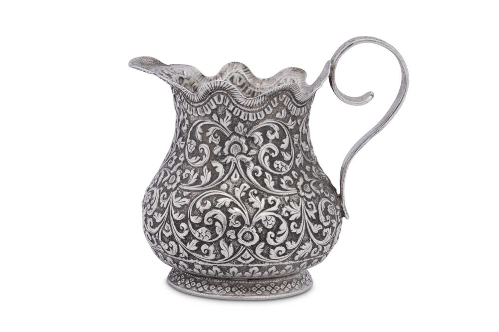 An early 20th century Anglo – Indian unmarked silver cream or milk jug, Cutch circa 1920 - Image 2 of 3